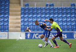 Luke Norris of Colchester United and Aaron Martin of Exeter City tussle for the ball - Mandatory by-line: Arron Gent/JMP - 18/06/2020 - FOOTBALL - JobServe Community Stadium - Colchester, England - Colchester United v Exeter City - Sky Bet League Two Play-off 1st Leg