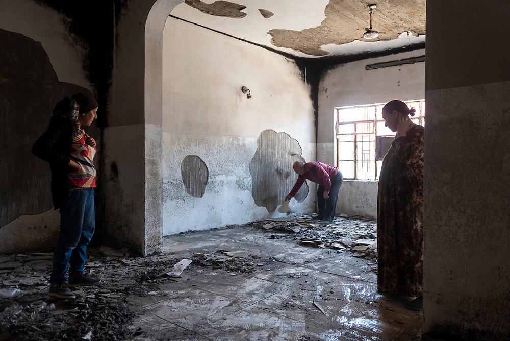 A Syriac Orthodox family begins the hard work of cleaning-up their home in Qaraqosh, Iraq. The destructive two-year ISIS occupation of this predominately Christian town ended on October 19, 2016. (May 5, 2017)