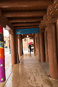 The adobe style covered walkway at the Museum of Contemporary Native Arts in the historic district during a winter snowfall December 12, 2015 in Santa Fe, New Mexico.