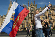 Russians and Russian-speakers from around the Russian Federation and former Soviet states such as the Baltics and of all generations, celebrate Victory Day, the annual commemoration remembering the sacrifice of Red Army heroes who defeated facism during WW2 - marching through the heart of British government in Whitehall, Parliament Square and ending outside Parliament itself, on 9th May 2018, in London, England.