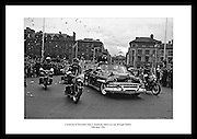 Cavalcade of President John F. Kennedy makes its way through Dublin, cheered on by thousands of spectators.<br /> <br /> 26th June 1963