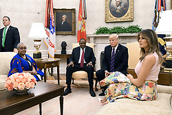 U.S. President Donald Trump (2-R) and First Lady Melania Trump (R) hold a bilateral meeting with Kenya's President Uhuru Kenyatta and Mrs. Margaret Kenyatta (L) in the Oval Office of the White House August 27, 2018 in Washington, DC. . Photo by Olivier Douliery/ Abaca Press