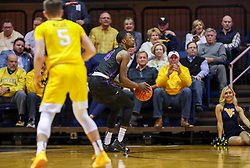 Mar 20, 2019; Morgantown, WV, USA; Grand Canyon Antelopes forward Oscar Frayer (4) shoots a three pointer during the second half against the West Virginia Mountaineers at WVU Coliseum. Mandatory Credit: Ben Queen