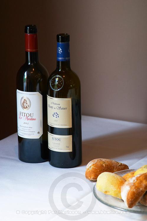 Fitou Le Maritime, Les Vignerons du Cap Leucate cooperative, Chateau Champ des Soeurs, L Maynadier with bread on a table. Fitou. Languedoc. France. Europe. Bottle.
