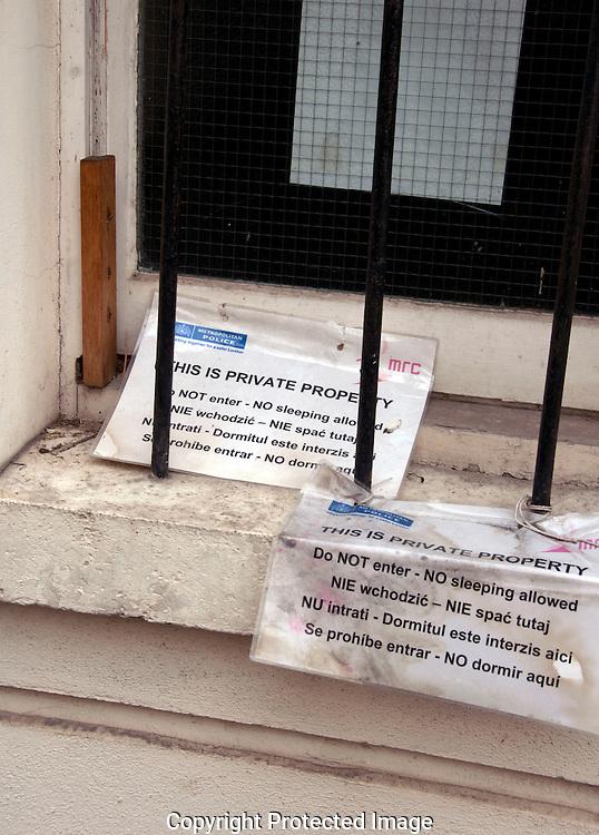 Metropolitan police notice forbidding homeless people to sleep in doorway in side street London