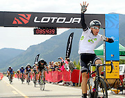Crossing the finish line in the record time of 8 hours, 45 minutes and 38 seconds, Cameron Hoffman holds up four fingers for his fourth win at LOTOJA on Saturday in Teton Village. The 32nd annual race from Logan, Utah to Jackson challenged cyclists through a diverse 200-mile route including three mountain passes.