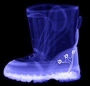 This is an X-ray of a child's boot with electronics.  The batteries are mounded in the sole of the boot and the lights are placed along the sides.  A motion detector in the sole controls the flashing of the lights (light emitting diodes) as the child walks.  These types of boots rise many security issues when a child travels with them on an airplane.  The layout of the electronics and batteries is almost identical to a terrorist bomb placed in the sole of the boot.