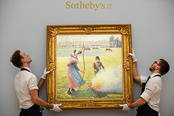 © Licensed to London News Pictures. 29/01/2020. LONDON, UK. Technicians hang ''Gelée Blanche, Jeune Paysanne Faisant Du Feu'' by Camille Pissarro, (Est. £8,000,000 - 12,000,000). Preview of Sotheby's Impressionist & Modern and Surrealist Art sales.  The auction will take place at Sotheby's New Bond Street on 4 and 5 February 2020.  Photo credit: Stephen Chung/LNP