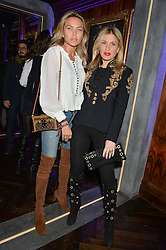 Left to right, TETYANA VERYOVKINA and HOFIT GOLAN at the launch of MNKY HSE Restaurant, 10 Dover Street, London on 19th October 2016.