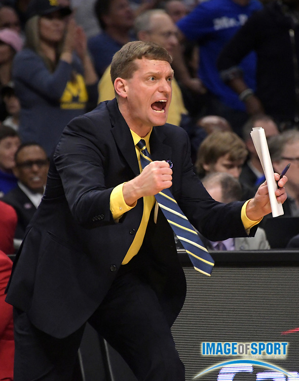 Michigan Wolverines assistant coach Luke Yaklich reacts during a West Regional semifinal of the NCAA men's college basketball tournament, Thursday, March 22, 2018, in Los Angeles. Michigan defeated Texas A&M 99-72.