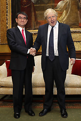 File photo dated 14/12/17 of Boris Johnson (right) shaking hands with Japan's Foreign Minister Taro Kono during his tenure as Foreign Secretary. Mr Johnson has been elected by Conservative party members as the new party leader, and will become the next Prime Minister of the United Kingdom.