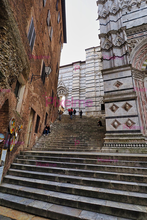 Stairs of the Facade of San Giovanni Baptistery of Siena Italy by day