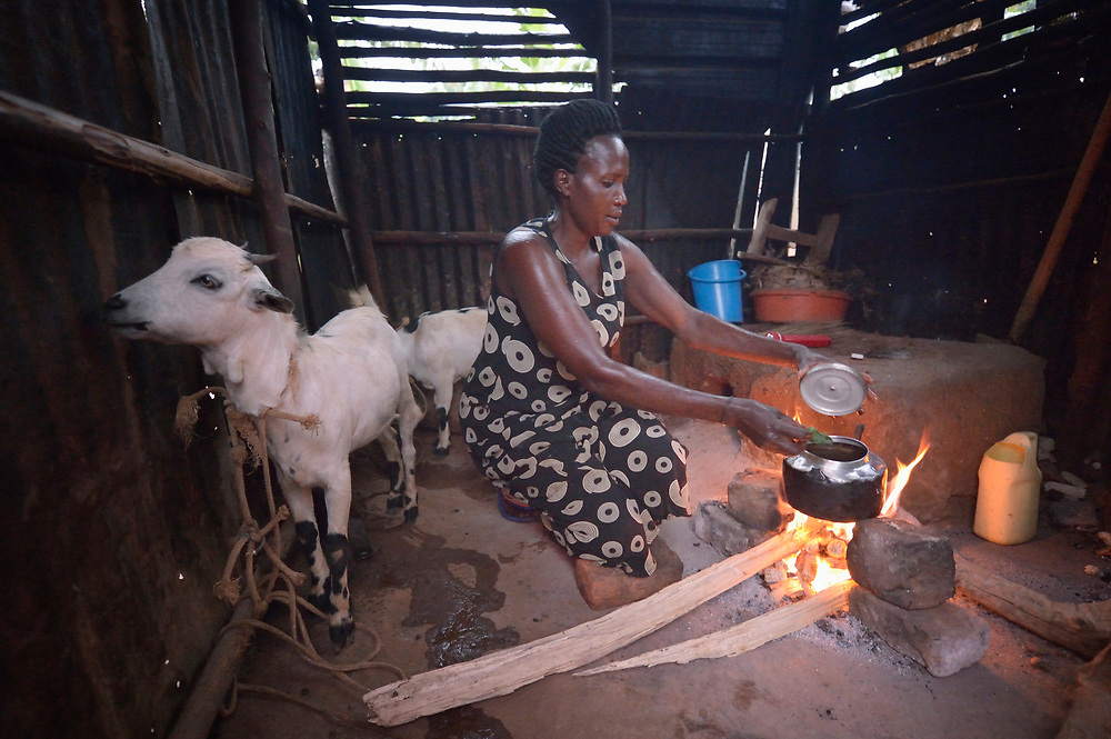 Grace Sebowa gets her cooking fire started in the morning in Kabulasoke, Uganda, where the Ntulume Village Women Development Association has trained women in improved agricultural practices, thus increasing food security and empowering women and children. Sebowa has been an enthusiastic participant in the program, which was supported by funding from the Call to Prayer and Self-Denial of United Methodist Women.