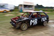 Another of the Mr Men team cars heads for crutineering. Note the rariator mounted behind the engine to reduce damage. Seen during the race meeting at Smallfield Raceway, Surrey, UK on the 10th of July 2011 (photo by Andrew Tobin/SLIK images)