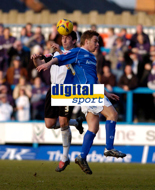 Photo: Leigh Quinnell.<br /> Chesterfield v Southend United. Coca Cola League 1. 18/02/2006. Southends Che Wilson gets to the ball before Chesterfields Jamie O'Hara(R)