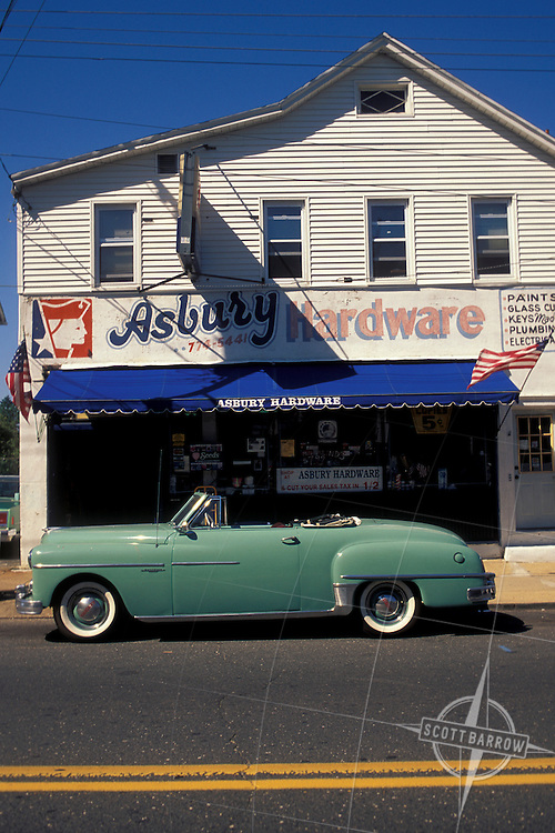 Old fashioned car parked outside of the Asbury Park, Hardware Store, New Jersey.