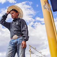 090514       Cable Hoover<br /> <br /> Jacob Todechine stand on the edge of the bucking chutes as he waits for his turn to compete in the Navajo Nation Fair Rodeo Saturday in Window Rock.