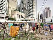 05 SEPTEMBER 2013 - BANGKOK, THAILAND:  The laundry of Cambodian workers dries on the line at the construction site of a new high rise apartment / condominium building on Soi 22 Sukhumvit Rd in Bangkok. The workers live in the corrugated metal dorms on the site. Most of the workers at the site are Cambodian immigrants.             PHOTO BY JACK KURTZ