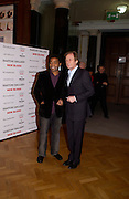 Bill Nighy and Chiwetel Ejiofor, 1st Anniversary party at the Saatchi gallery for the private view of Young Blood. 23 March 2004. ONE TIME USE ONLY - DO NOT ARCHIVE  © Copyright Photograph by Dafydd Jones 66 Stockwell Park Rd. London SW9 0DA Tel 020 7733 0108 www.dafjones.com