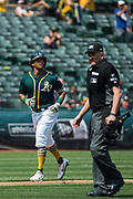 Oakland Athletics left fielder Khris Davis (2) hits a solo home run against the Los Angeles Angels at Oakland Coliseum in Oakland, California, on September 6, 2017. (Stan Olszewski/Special to S.F. Examiner)