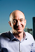 Portrait of Jeff Bezos, CEO of Amazon.com.  Photographed at Amazon.com offices in Seattle, WA. Blue sky background.