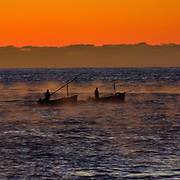 Fishermen in the mist in Cornwall at Sunrise.