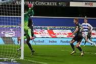 Queens Park Rangers (QPR) goalkeeper Seny Dieng (13) battles for possession whilst making save during the EFL Sky Bet Championship match between Queens Park Rangers and Rotherham United at the Kiyan Prince Foundation Stadium, London, England on 24 November 2020.