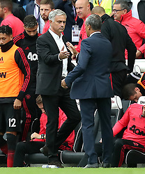 Manchester United manager Jose Mourinho (left) and Brighton & Hove Albion manager Chris Hughton (right) shake hands after the final whistle during the Premier League match at the AMEX Stadium, Brighton.