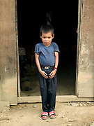Portrait of a Ko Pala ethnic minority boy in Ban Honglerk, Phongsaly province, Lao PDR