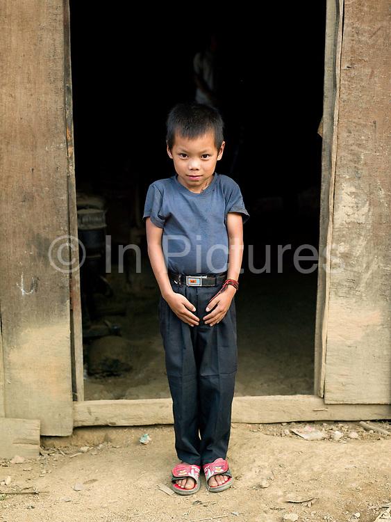 Portrait of a Ko Pala ethnic minority boy in Ban Honglerk, Phongsaly province, Lao PDR