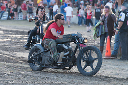 Iron Lily Kissa Von Addams and Brad Gregory having a good time on the track in front of the stage at the Buffalo Chip during the annual Sturgis Black Hills Motorcycle Rally.  SD, USA.  August 10, 2016.  Photography ©2016 Michael Lichter.