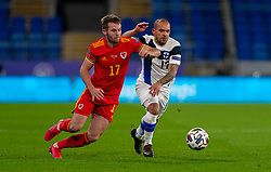 CARDIFF, WALES - Wednesday, November 18, 2020: Wales' Rhys Norrington-Davies (L) and Finland's Nikolai Alho during the UEFA Nations League Group Stage League B Group 4 match between Wales and Finland at the Cardiff City Stadium. Wales won 3-1 and finished top of Group 4, winning promotion to League A. (Pic by David Rawcliffe/Propaganda)