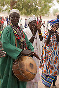 Griot players and a dance troop perform for the village chief of Barani and locals during the FECHIBA horse festival in northern Burkina Faso.