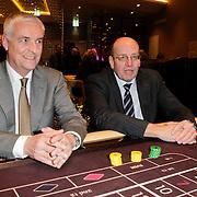 NLD/Schveningen/20120307 - Heropening Holland Casino Scheveningen, bestuursvoorzitter Dick Flink en staatsecretaris Fred Teeven van Veiligheid en Justitie aan de roulettetafel