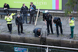 "© Licensed to London News Pictures . Manchester , UK . FILE PICTURE DATED  06/10/2013 of police examining a body floating in a canal , prior to recovering it . Police pulled a body from The Bridgewater Canal in Manchester , adjacent to the City's "" Gay Village "" on Canal Street . Greater Manchester Police have issued a statement after suggestions that a number of deaths in and around Manchester's canals may be linked to a serial killer , named in local folklore as "" The Pusher "" . The statement said "" Absolutely no evidence whatsoever of foul play has been established "" . Photo credit : Joel Goodman/LNP"