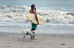 October 7, 2016 - Florida, U.S. - Matt Arens, Jupiter and his dog Roscoe at Jupiter Beach Park on Friday morning. (Credit Image: © Melanie Bell/The Palm Beach Post via ZUMA Wire)