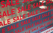 Sale Sign in fashion retail shop window in London. This is classic winter sale promotion as happens every year.