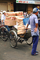 """Binh Tay Market was built by a Chinese businessman named Quach Dam. He was best known by his nick-name """"Handicapped Thong"""" among local Chinese. He started out very poor making a living by recycling garbage and other used material.  Later he began to enter into other types of businesses, in which he earned his fortune before building the market."""