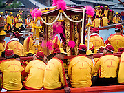 """23 JUNE 2015 - MAHACHAI, SAMUT SAKHON, THAILAND: The City Pillar Shrine on a fishing boat on the Tha Chin (Chin River) in Mahachai. The Chaopho Lak Mueang Procession (City Pillar Shrine Procession) is a religious festival that takes place in June in front of city hall in Mahachai. The """"Chaopho Lak Mueang"""" is  placed on a fishing boat and taken across the Tha Chin River from Talat Maha Chai to Tha Chalom in the area of Wat Suwannaram and then paraded through the community before returning to the temple in Mahachai.   PHOTO BY JACK KURTZ"""