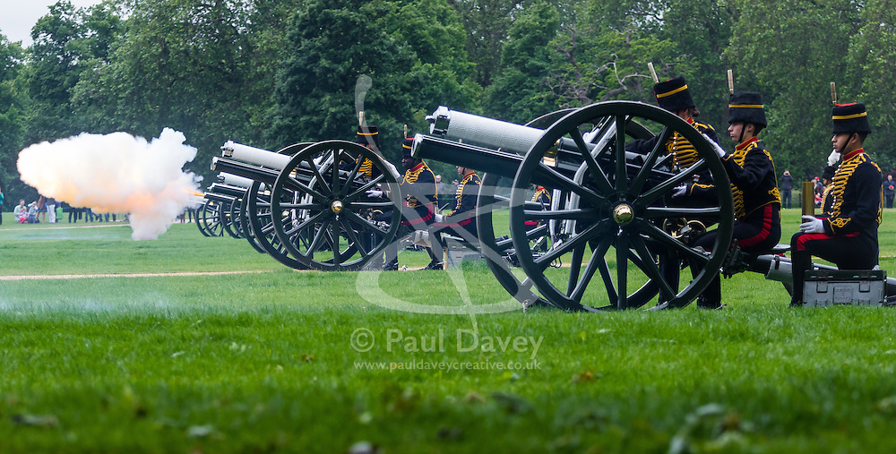 Hyde Park, London, June 2nd 2016. Soldiers and guns of the King's Troop Royal Horse Artillery fire a 41 round Royal Salute to mark the 63rd anniversary of the coronation of Britain's Monarch HM Queen Elizabeth II. PICTURED: A burst of smoke and flame erupts from the barrel of a gun.