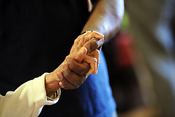 A close up of  elderly Sikh ladies hand, as she is helped to her chair, in a care home, Bradford, West Yorkshire