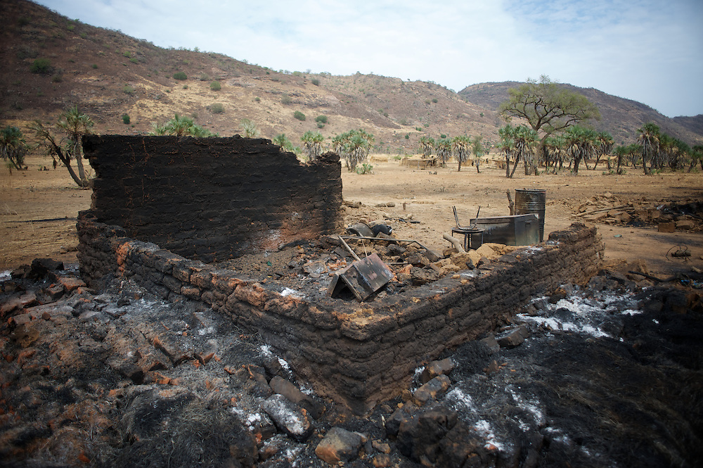April 29, 2012 - Al Kanyard, Nuba Mountains, South Kordofan, Sudan: General view of a an house destroyed by Sudan's Army warplanes in the village of Al Kanyard. Two children and an adult died during the bombardments and other three suffered severe burn injuries...Since the 6th of June 2011, the Sudan's Army Forces (SAF) initiated, under direct orders from President Bashir, an attack campaign against civil areas throughout the South Kordofan's province. Hundreds have been killed and many more injured...Local residents, of Nuba origin, have since lived in fear and the majority moved from their homes to caves in the nearby mountains. Others chose to find refuge in South Sudan, driven by the lack of food cause by the agriculture production halt due to the constant bombardments of rural areas. (Paulo Nunes dos Santos/Polaris)