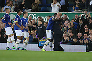 Romelu Lukaku of Everton celebrates with his manager  Ronald Koeman after he scores his teams 1st goal. Premier league match, Everton v Crystal Palace at Goodison Park in Liverpool, Merseyside on Friday 30th September 2016.<br /> pic by Chris Stading, Andrew Orchard sports photography.