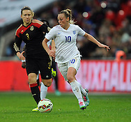 Toni Duggan of England Women is chased by Josephine Henning of Germany Women<br /> - Womens International Football - England vs Germany - Wembley Stadium - London, England - 23rdNovember 2014  - Picture Robin Parker/Sportimage