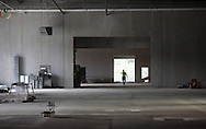 A worker walks through the maintenance area of the new Coach USA garage and headquarters under construction in Chester on Monday, Sept. 16, 2013.