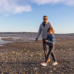 A man and his daughter explore the Mowry Beach Preserve in Lubec, Maine.