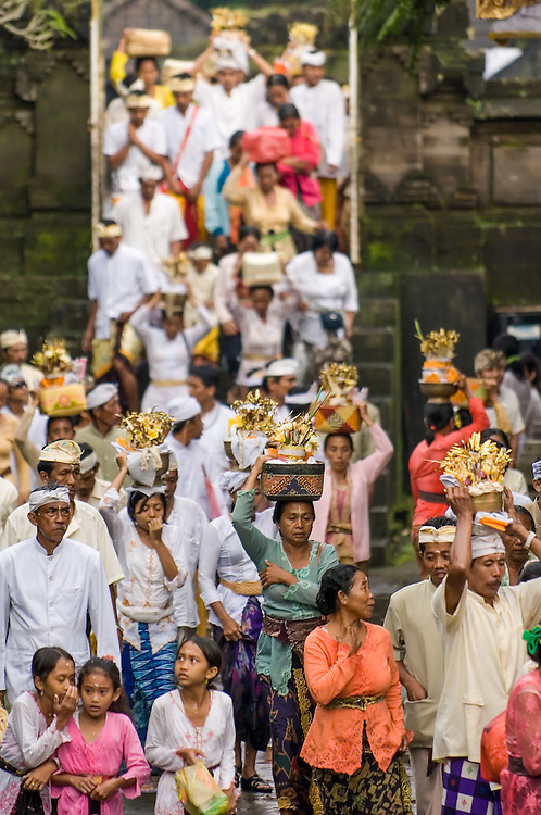 Stock photograph of Hindu devotees filing in with offerings for Nyepi at Besakih Temple in Bali