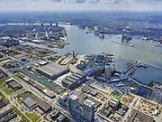Nederland, Noord-Holland, Amsterdam; 17-04-2021; Amsterdam-Noord, voormalige NDSM-werf met directe omgeving. Pontkade met aanlanding van de pont, Werfstraat en NDSM-straat, Ms. Van Riemsdijkweg. NDSM Loods. Linksonder Klaprozenweg. Zicht op het IJ met Centraal Station<br /> Amsterdam-Noord, former NDSM wharf with direct surroundings. Pontkade with landing of the ferry, Werfstraat and NDSM street, Ms. Van Riemsdijkweg. NDSM engine house.<br /> <br /> luchtfoto (toeslag op standaard tarieven);<br /> aerial photo (additional fee required)<br /> copyright © 2021 foto/photo Siebe Swart