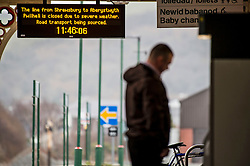 © London News Pictures. 08/02/2016. Aberystwyth, UK.  A cancellation notice at the train station in Aberystwyth after where lines have been closed following by Storm Imogen . Debris from the beach and ripped up pavement slabs litter the promenade and seafront road. Photo credit: Keith Morris/LNP