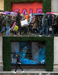 COMBINATION IMAGE © Licensed to London News Pictures. 26/12/2020. London, UK. In this combination image shoppers are seen queuing at Selfridges on Boxing Day in 2019 (TOP) and the same scene today (LOWER). On one of the busiest shopping days of the year a near deserted Oxford Street as all non-essential shops remain closed due to the continuing coronavirus pandemic that has swept through the World. Last week Health Secretary Matt Hancock announced that yet another new Covid-19 mutation has been discovered in the UK as Downing Street orders many more areas of England to go into Tier 4 lockdown from Boxing Day with tougher new Covid-19 restrictions for many as the mutated strains continue to spread throughout the South East. Photo credit: Alex Lentati/LNP